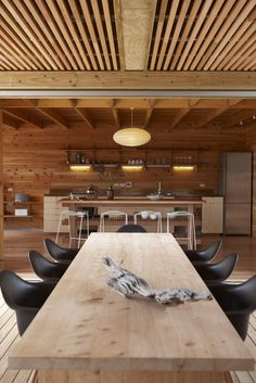 Awesome way to cover up a drop ceiling: 2x2 unfinished wood, suspended from existing drop ceiling frame works.