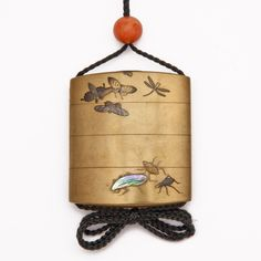 A three case gold lacquer inro decorated in mother-of-pearl and taka-maki-e with butterflies, grasshoppers, fireflies and beetles.  Signed Naotaka   Height 7cm  Circa 1850