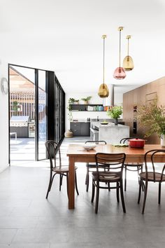 This 1980s Melbourne brick home was re-designed to be eco-friendly with a kitchen including energy efficient appliances and lighting. Photography: Martina Gemmola   Styling: Ruth Welsby