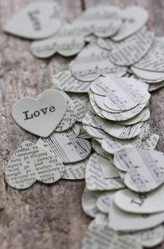 Love Confetti. - could be done with recycled books or music sheets and a large hole punch