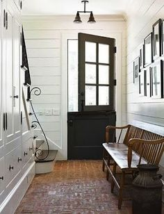"Dutch Doors: ""Beautiful floors, built-in under-stair storage, a lovely wooden bench, paneled wooden walls, and a gorgeous Dutch door."""