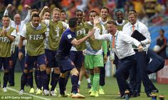 Happy Holland: Louis van Gaal high fives Van Persie after the forward's brilliant equalise...