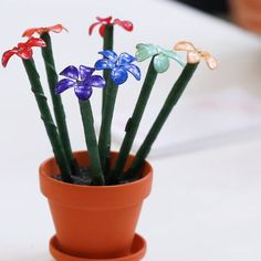 Rainbow Dipped Nail Polish Flowers // #crafts #diy #nailpolish #crafty #Nifty #FlowerCrafts