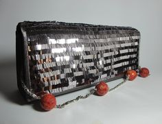 Gray satin clutch with pailletes, madrepora and freshwater pearls. The chain can be used as a necklace. Nickel free