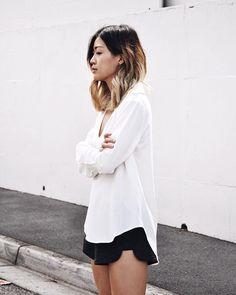 Black shorts, white knit/sweater