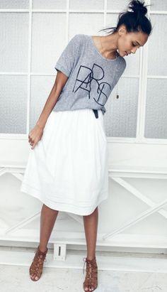 White midi skirt and graphic tees.