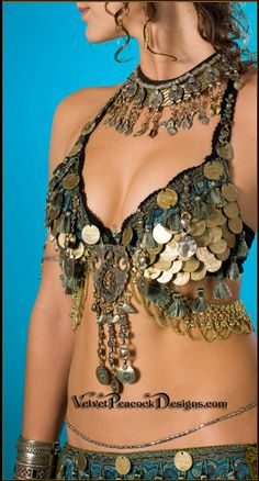 I am starting to notice a pattern of which costumes I am most drawn to: They are usually heavily decorated with coins (as in this tribal bra - beautiful, by the way), bold colors, and flowy, feminine skirts. Lots of junk hanging from the bra is good too!
