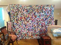 No two fabrics are alike.  King size.  More than 2500 2 1/2 inch squares, and the back is all scraps....