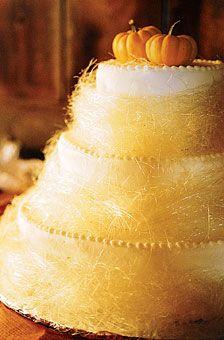 pumpkin spice cream cheese cake with haylike spun sugar and mini-pumpkins
