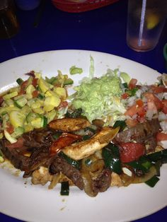Chicken and Beef fajita with mixed veggies and guacamole