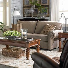 """This is our living room set - painted the accent wall with Benjamin Moore """"rustic taupe"""" would love recommendations for a couple red items to accent, maybe vases, maybe a piece of artwork to hang behind the sofa. Taupe Living Room, Living Room Redo, Home Living Room, Living Spaces, At Home Furniture Store, New Furniture, Furniture Ideas, Upholstered Sofa, Home Furnishings"""