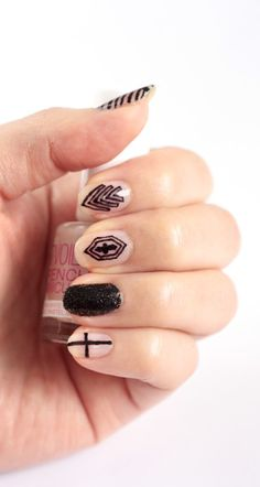 I like the high school grunge look of this black sharpie nail art