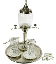 beautiful absinthe fountain! more taps would also be nice - and those lovely pretty spoons too