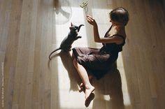 Girl playing with cat by Lyuba Burakova for Stocksy United