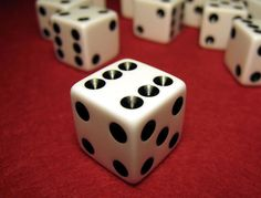 Roll the Dice | Closeup of dice on red felt table.