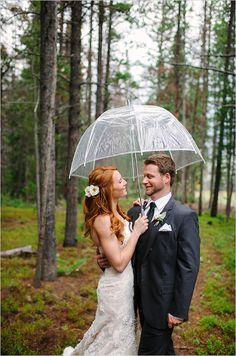 Rainy day wedding portrait ideas. Captured By: Michele Hart Photography ---> http://www.weddingchicks.com/2014/05/29/rain-and-shine-rustic-colorado-wedding/