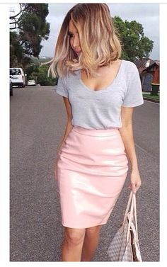 Pastel pink PVC skirt and a grey tshirt.  Has a surprisingly casual look x