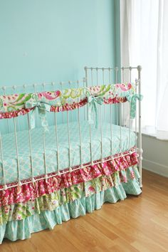 Love the style of bed skirt! Love the teething rail protector idea, would work as well with our crib, but really like the idea! Nursery Decor: Bumper-Less Paisley Pink, Blue, and Green Kumari Garden Baby Girl Bedding Crib Set with Teething Rail Protector
