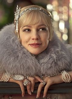 Carey Mulligan as Daisy in the Great Gatsby. Daisy is a wealthy, privileged flapper during the decadent Roaring 20's. In order to support the theme of the  crumbling American dream, the author may have used the shallow Daisy to contrast with actual working class flappers who possessed activist mindsets during that period. Perhaps the author deliberately used this wealthy character who lacked conscience to illustrate his point. Or perhaps he just overlooked flappers' real significance in…