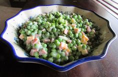 So easy to make and perfect for spring (or anytime!)  Peas, cheese and ham are dressed lightly in yogurt for a fresh side dish you are going to love.  Perfect for Easter, a BBQ or a weeknight dinner!