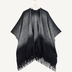 Super soft, oversized and with delicate fringing on the edges, this cape could well be the cosiest throw-on piece you'll ever own. Pop it in your bag wherever you go- it's the perfect cold-weather winner.