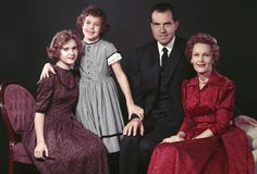 A portrait of Richard Nixon with his daughters Tricia Nixon and Julie Nixon, and wife Pat Nixon.