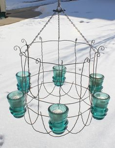 cute outdoor chandelier made from upside down garden fencing glass insulators see easy diy @ Ranger Come on baby light my fire. Outdoor Chandelier, Outdoor Lighting, Diy Chandelier, Iron Chandeliers, Vintage Chandelier, Wire Lighting, Chandelier Planter, Chandelier Creative, Bottle Chandelier