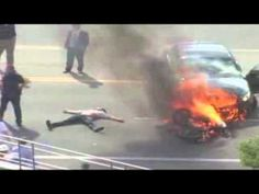 www.youtube.com Bystanders Save Trapped Cyclist Under Burning Car