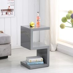 Miami Side Table In Grey High Gloss With S shape design makes a stylish look in your home decor Finish: Grey High Gloss Features: •Miami Side Table In Grey High Gloss With Shelves •Grey H...