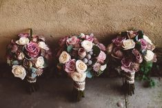 Berry pink & Cream bridal bouquet & bridesmaid posies - Image by  Christopher Currie Photography - An Essense of Australia wedding dress for a Winter wedding at  Kinkell Byre in Scotland with a pastel rose bouquet photographed by Christopher Currie.