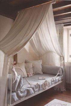 white beds draped with white curtains | ... IN SHADES OF WHITE & A SEWING MACHINE BASE REPURPOSED INTO A TABLE