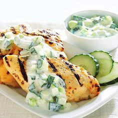 Grilled Chicken with Cucumber Yogurt Sauce Green onions, fresh mint, and cumin season the cool yogurt sauce that tops this grilled chicken. It's a fast dinner for busy evenings.