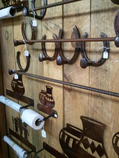 Coat rack and towel bars from Santa Fe, NM. Made from railroad nails, horseshoes, and rebar.