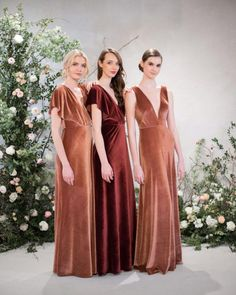 Jenny Yoo Bridesmaids, long modern bridal party dresses shown in shades of dark berry burgundy red / a rustic shade of burnt orange. These modern and unique guest of wedding / occasion dresses in luxurious stretch velvet would be perfect for a summer, spring, fall or winter wedding! The glamorous new 2018 Jenny Yoo Bridesmaids Collection features deep v cuts, open backs, dramatic slits, stylish halter necklines, and trendy spaghetti straps! Available in many colors. Photography by Kat