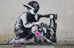 A new work by Graffiti artist Banksy in North London UK.