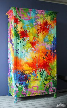 I dunno, but it's interesting. Colorful Spray Painted Armoire. No tutorial available.