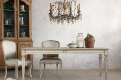 Dining table and chairs reproduction available through Dasan Interiors Inc.