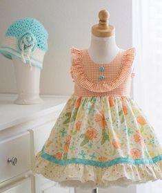 NEW 2017 Girls handmade Clementine Dress. Lovely shades of aqua and orange on a creamy color floral background fabric. Details include: Flutter Sleeves Sewn-in Sash Cotton Fabric Made in the USA. Published using Nembol Frocks For Girls, Little Girl Dresses, Girls Dresses, Baby Frocks Designs, Kids Frocks Design, Toddler Dress, Baby Dress, Girls Frock Design, Baby Girl Dress Patterns