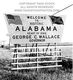 Roadside welcome to Alabama sign with Confederate Flag advertising the governorship of George Wallace.
