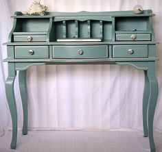 Blue secretary desk. Would be great in an entry way or at the end of a hallway.