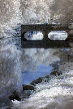 Stone Bridge Over a Slow River. Milham Park, Kalamazoo, Michigan, USA