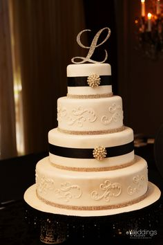 Classic black and white wedding cake with monogrammed cake topper by Edible Designs by Jessie