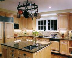 amusing-granite-countertops-with-oak-cabinets-hanging-pan-
