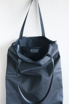 handmade backpack / tote out of light water-repellent dyneema gridstop. black and white.