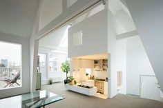 Revamp Transforms Apartment Into Airy Loft With a Cool Sunken Kitchen - Curbed