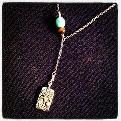 Lotus lariat necklace