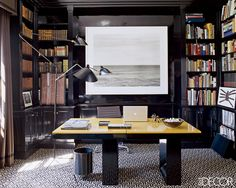 Aerin Lauder's East Hampton library / office comes complete with a Serge Mouille lamp, art by Chip Hooper and carpeting by AM Collections.