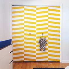 DIY herringbone closet doors in a little boy's nursery! Using Easy Stripe from @wallsneedlove by @LovelyIndeed!