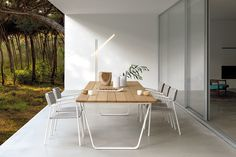 Outdoor dining chair by Manutti. Teak and powdercoated aluminium. Belgian Design.