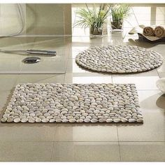 I used: 1 rubber Welcome mat 4 bags of river rocks some contact adhesive All from the Dollar store.